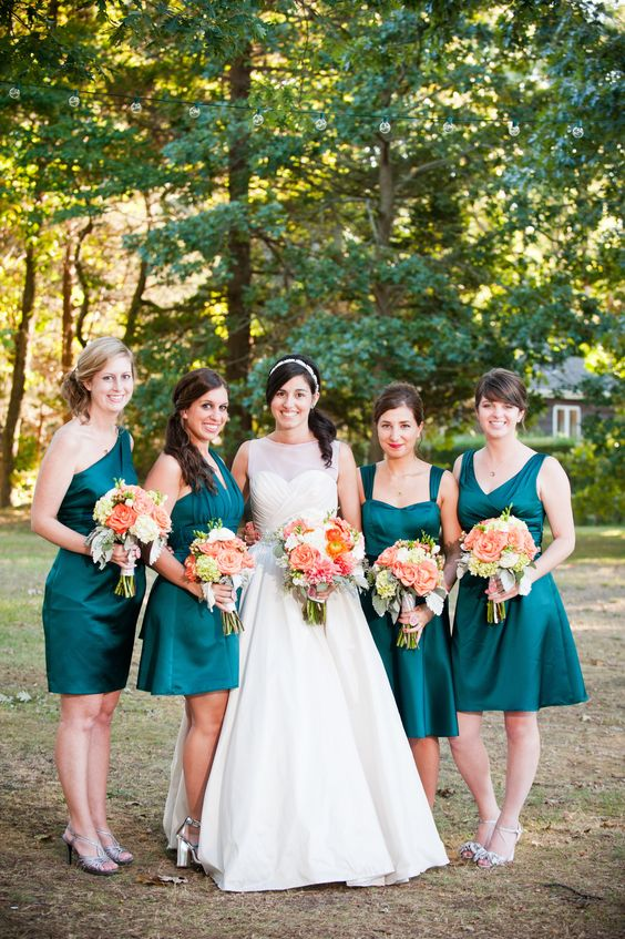 teal mismatching bridesmaids' dresses and bouquets with touces of copper and orange