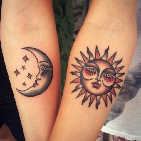 Sun and moon tattoos on the both hands