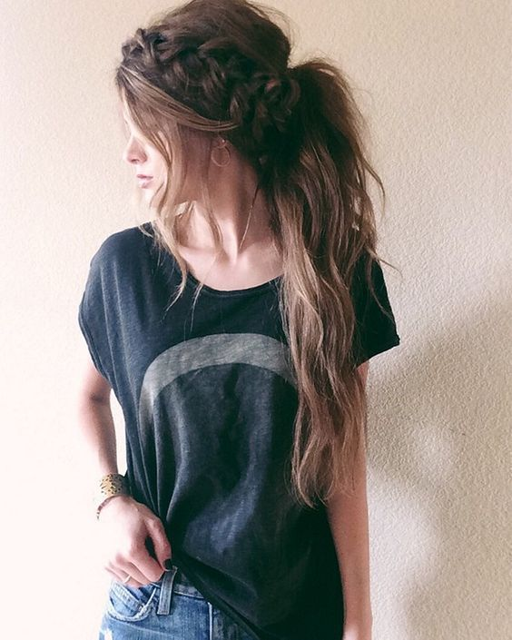 loose and messy low ponytail with a large braid and some hair down