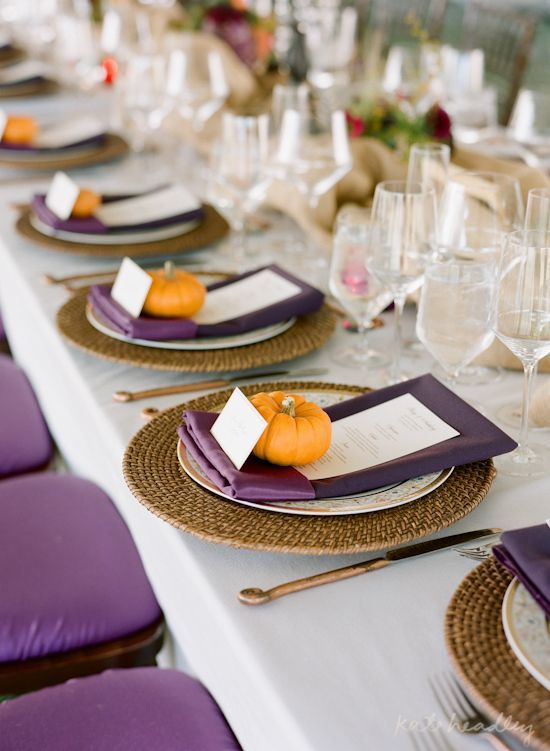 small orange pumpkins as card holders spruce up a purple and cream wedding color combo