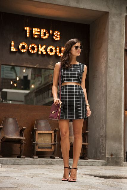 a black and white windowpane set with a crop top and a mini skirt, heeled sandals