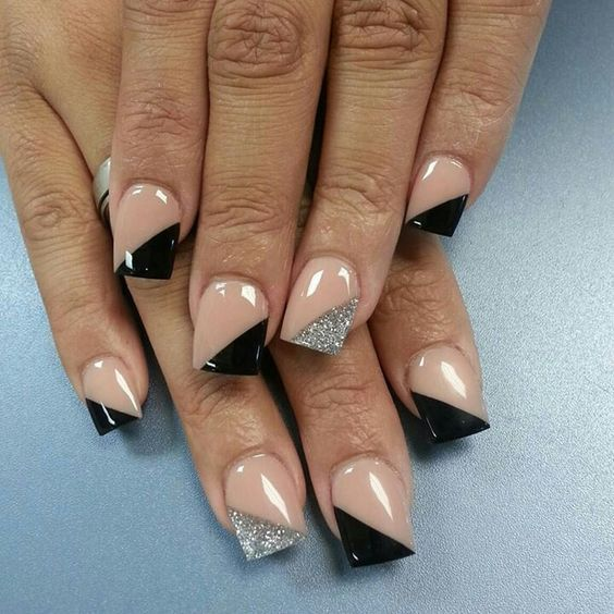 geometric nails with black and silver glitter triangles