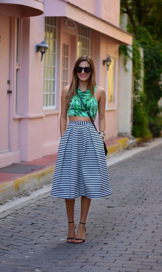 a tropical leaf print haltern neckline crop top, a black and white striped midi skirt and black heels