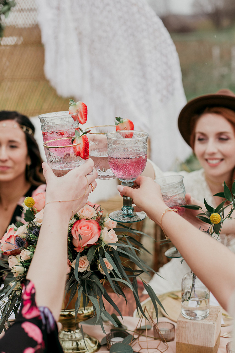 wedding toasts - photo by Sarah White Photography http://ruffledblog.com/boho-bridal-shower-inspiration-for-your-bride-tribe