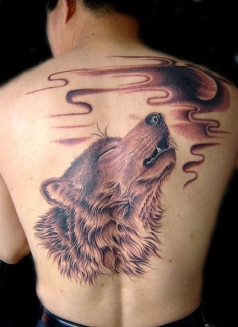 Large wolf tattoo on the back