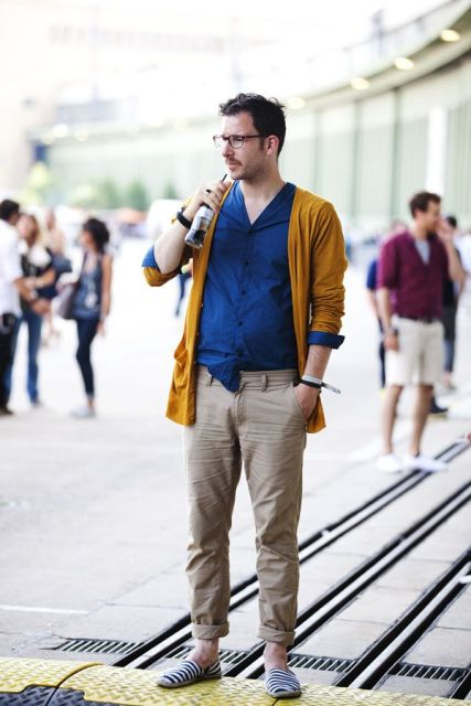 With navy blue shirt, yellow blazer and beige pants