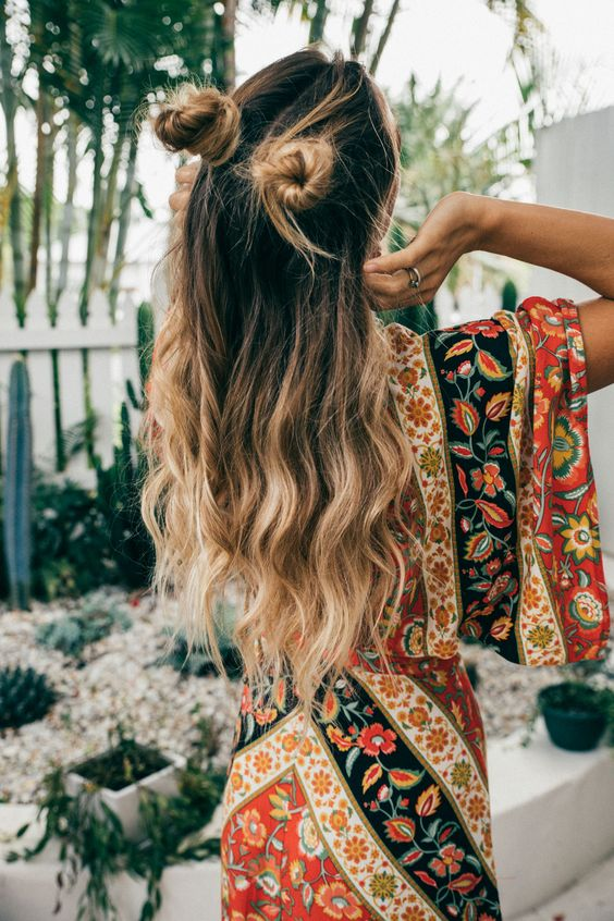 half updo with long waves down and two funny buns