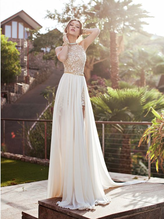 a short lace gold and white dress with a plain overskirt with a slit for the ceremony