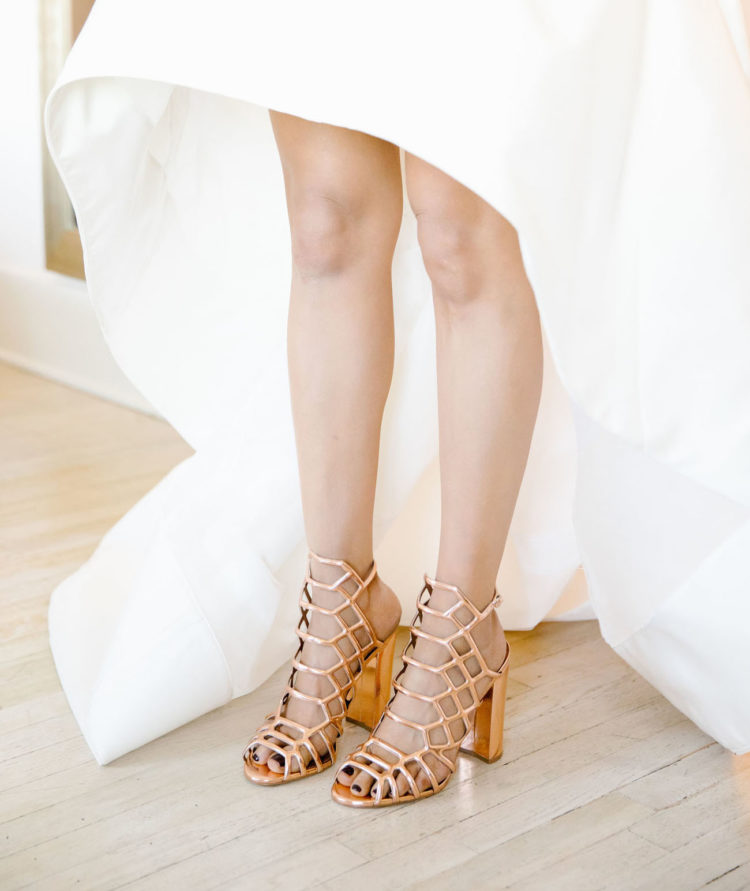 The bride was wearing gorgeous rose gold wedding shoes by Steve Madden