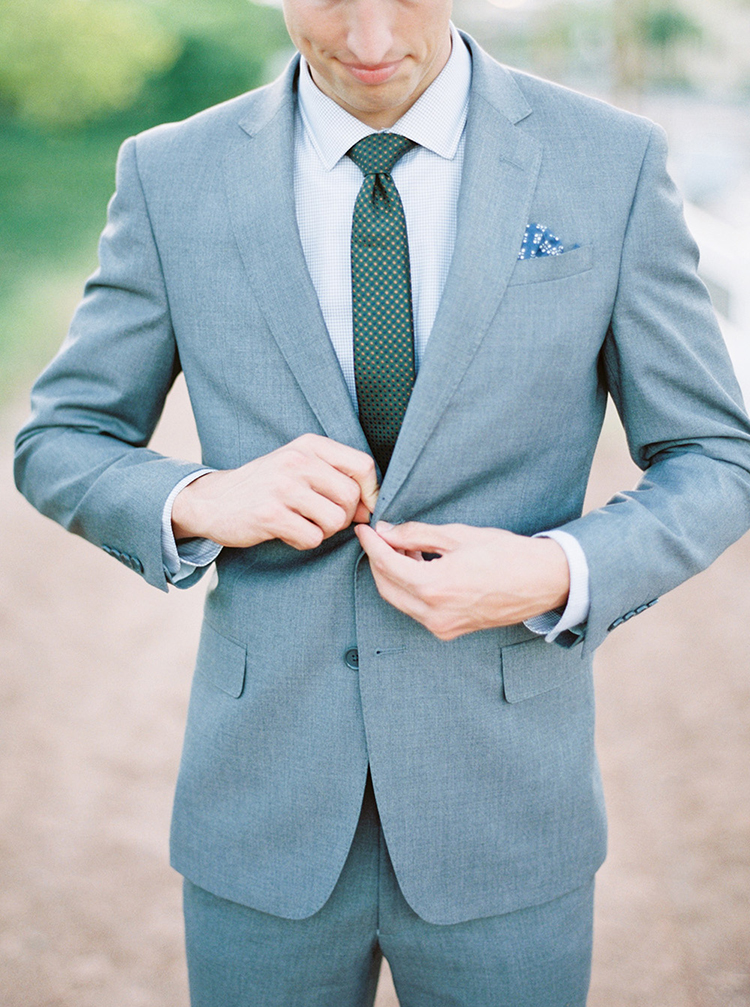grey grooms suits - photo by Melissa Jill Photography http://ruffledblog.com/citrus-and-copper-orchard-wedding-inspiration