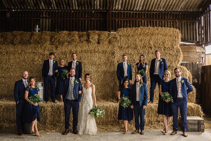 The bridesmaids and groomsmen in navy