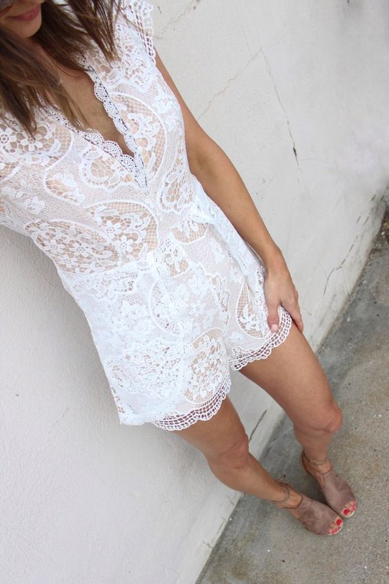 a white lace romper with a V-neckline and suede shoes