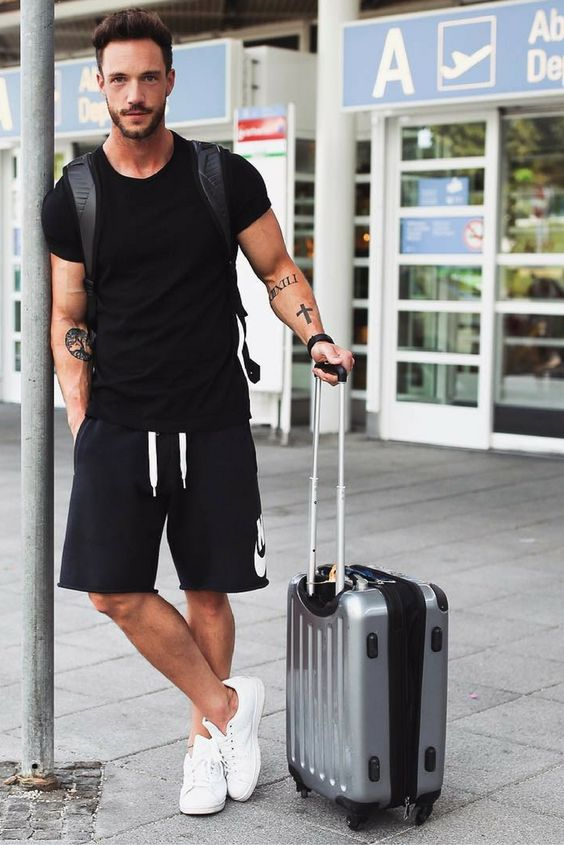 a black t-shirt, black Nike shorts, white sneakers and a backpack for comfy travelling