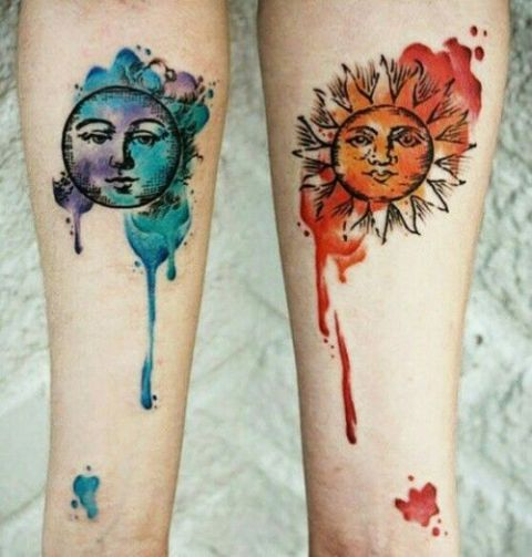 Red sun and blue moon tattoos on the arms