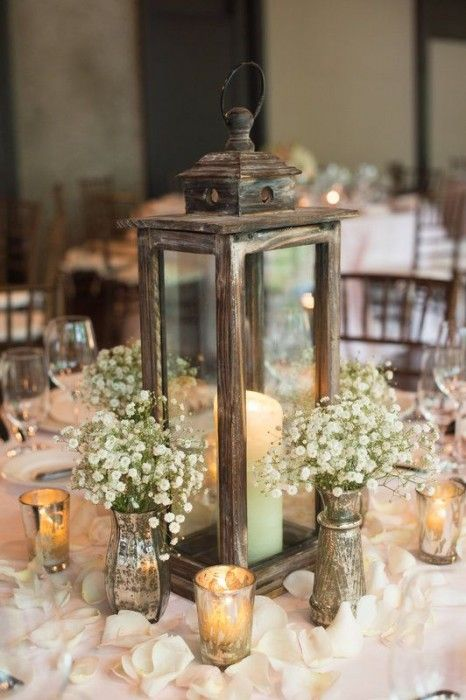 a reclaimed wood candle lantern, baby's breath in mercury glass vases and candles for a cute centerpiece