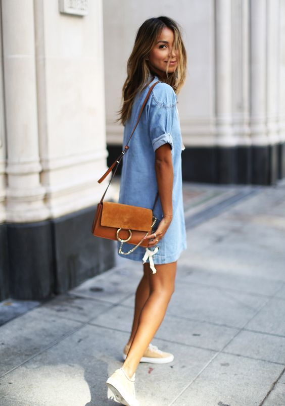a chambray mini dress, sneakers and a brown leather bag