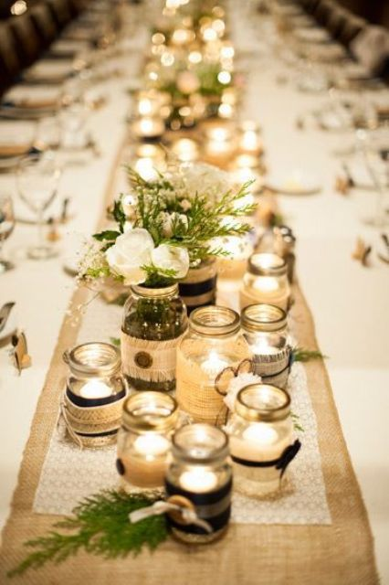 jars covered with lace and burlap, with candles inside and blooms and greenery
