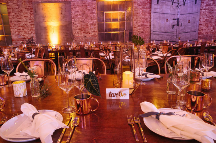 The wedding table setting was done in a blend of vintage, industrial and tropical styles and looked cute and welcoming