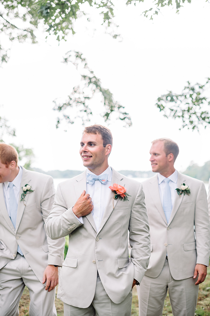 The groom and groomsmen were wearing neutral suits, white shirts and blue ties