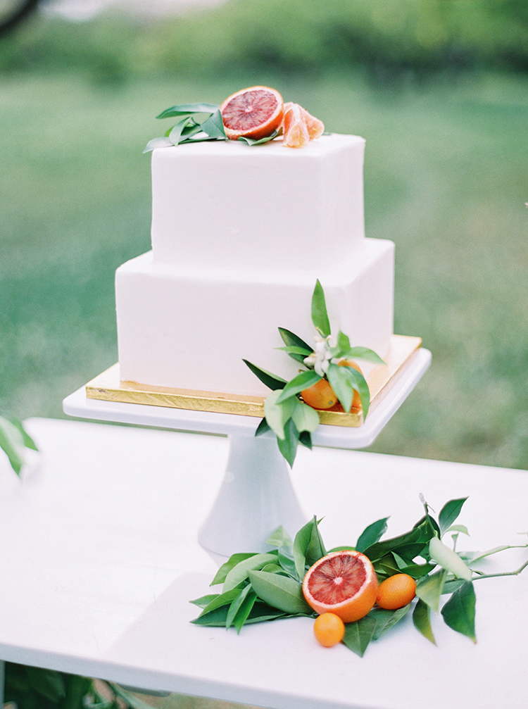 citrus topped wedding cakes - photo by Melissa Jill Photography http://ruffledblog.com/citrus-and-copper-orchard-wedding-inspiration
