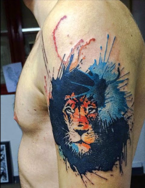 Lion with blue splashes tattoo