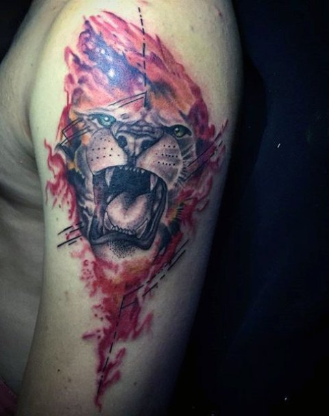 Roaring lion tattoo on the arm