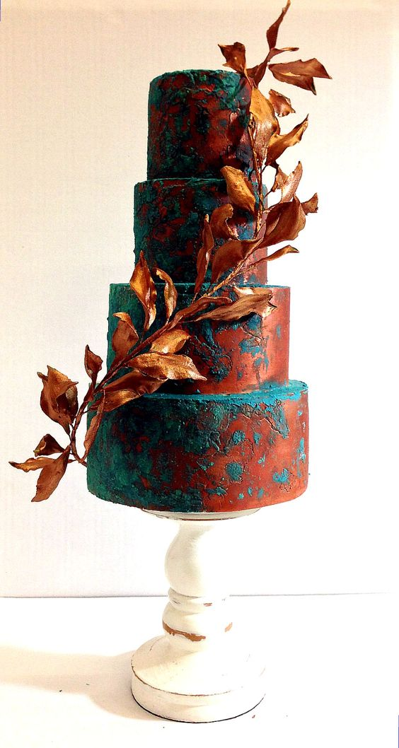 artsy wedding cake decorated with matte copper and teal plus a copper leaf branch