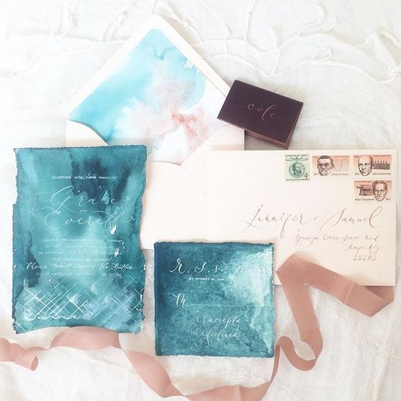 beautiful watercolor teal wedding stationary with white calligraphy and copper details