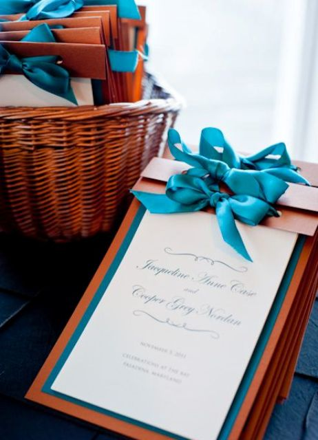 teal and copper ceremony programs with bows