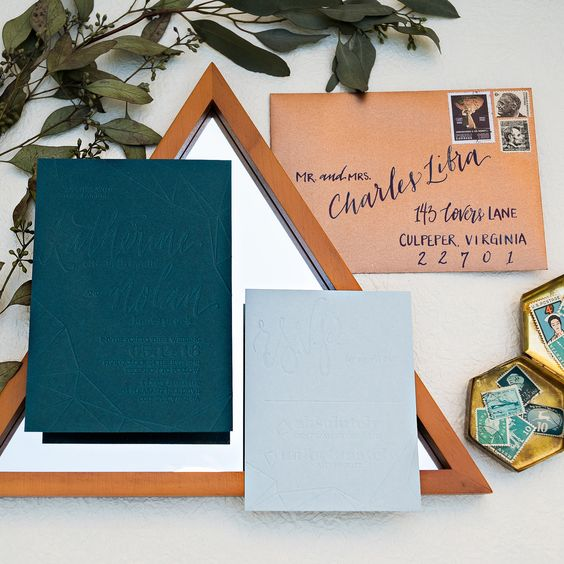 pressed teal and copper wedding invites for a mid-century modern wedding