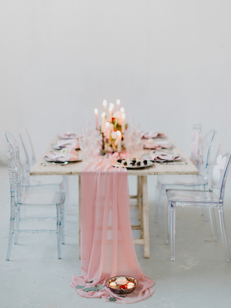 pink fabric table runners - photo by Linda Nari Photography http://ruffledblog.com/tuscan-warehouse-wedding-inspiration-with-a-floral-bridal-gown