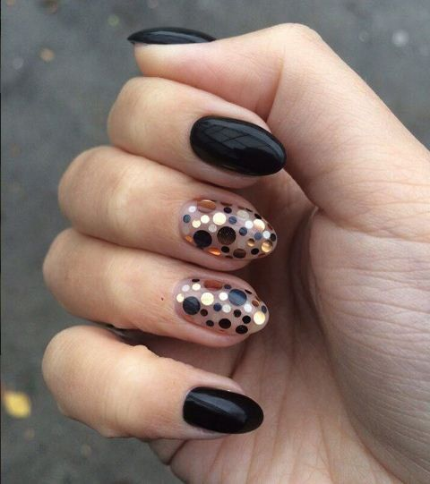 black rounded nails with accent polka dot nails in gold, copper and black