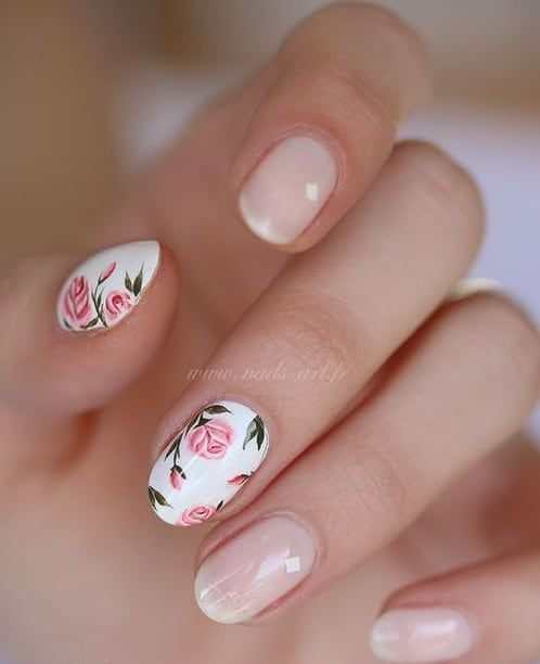 blush nails and pink rose accent nails for a feminine look