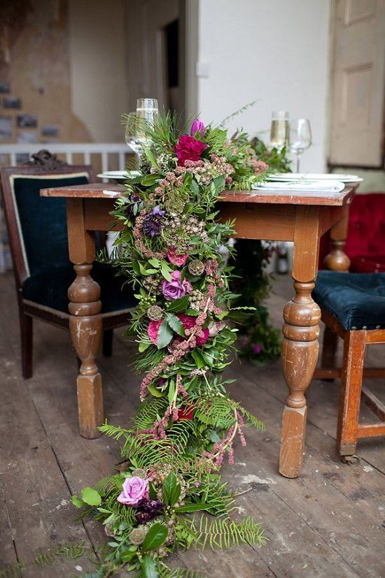 lush greenery, pink, fuchsia and purple blooms for a luxurious table runner