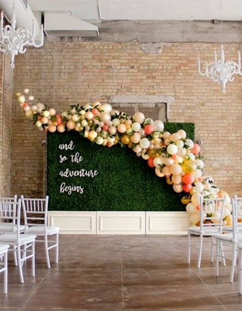 a living wall with a colorful balloon curve for a cool wedding backdrop