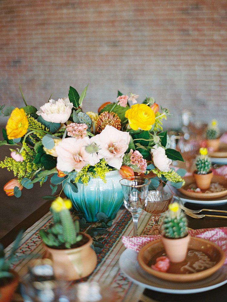 bohemian colorful centerpieces - photo by Charla Storey Photography http://ruffledblog.com/summer-loving-wedding-inspiration-with-a-fiesta-brunch