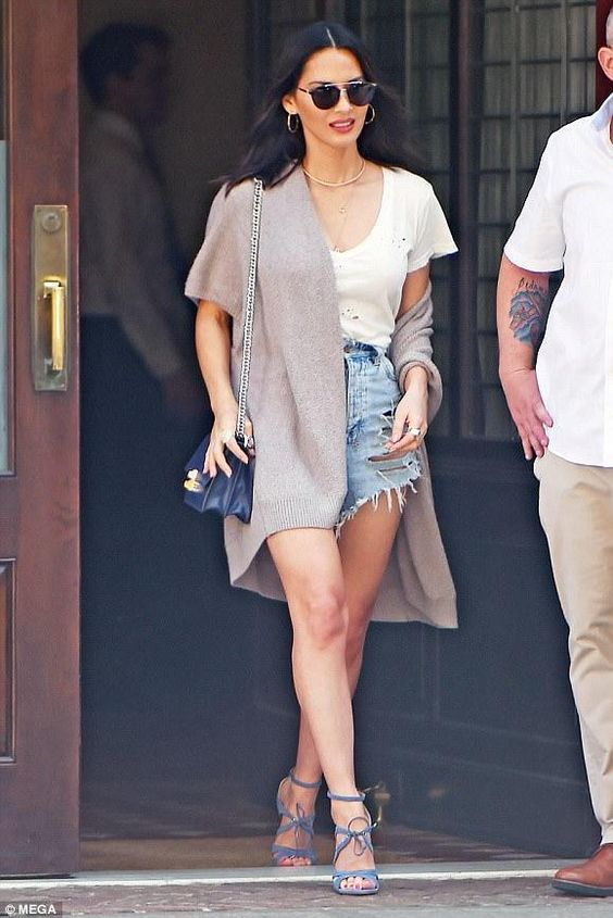 blue distressed denim shorts, a white distressed tee, blue lace up heels and a neutral cardigan