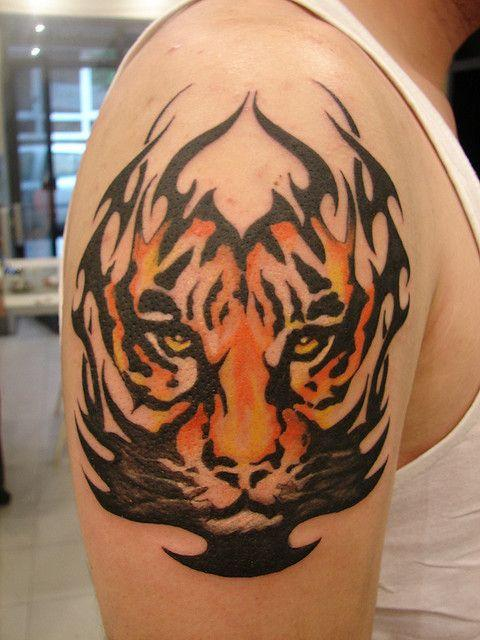 Half-sleeve tribal colored tiger tattoo