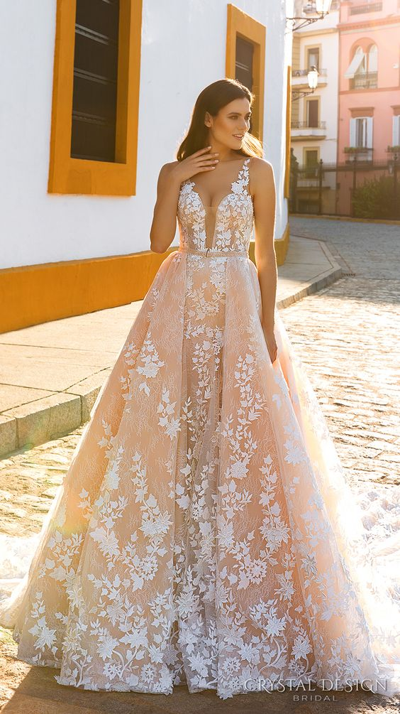 pink lace applique strap illusion plunging neckline wedding dress with an overskirt
