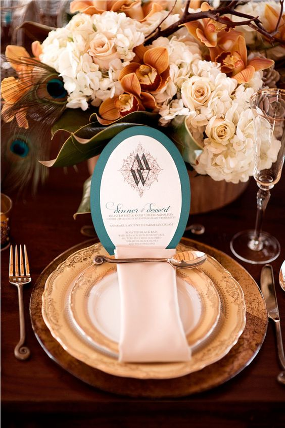 copper flatware, chargers and teal and white wedding menu look refined