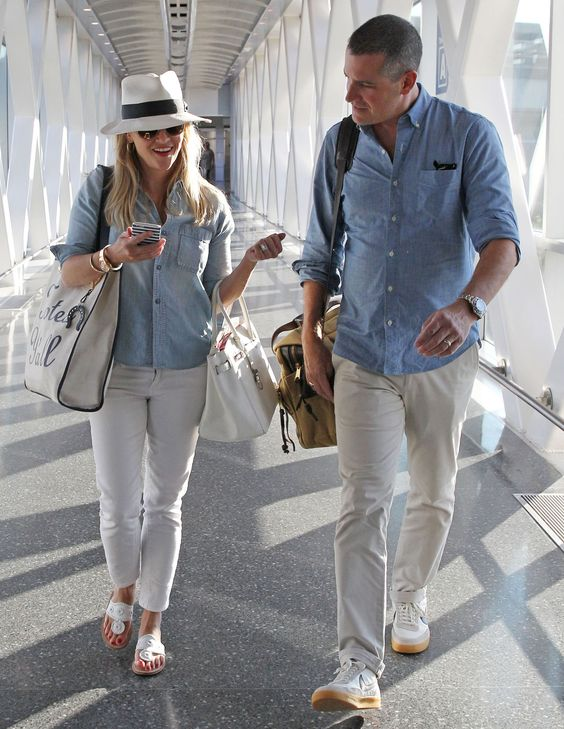 Exclusive... 51818428 Couple Reese Witherspoon and Jim Toth arriving on a flight in Boston, Massachusetts on August 7, 2015. The pair were heading to their second flight to Nantucket but were informed that the airline had lost their luggage. FameFlynet, Inc - Beverly Hills, CA, USA - +1 (818) 307-4813