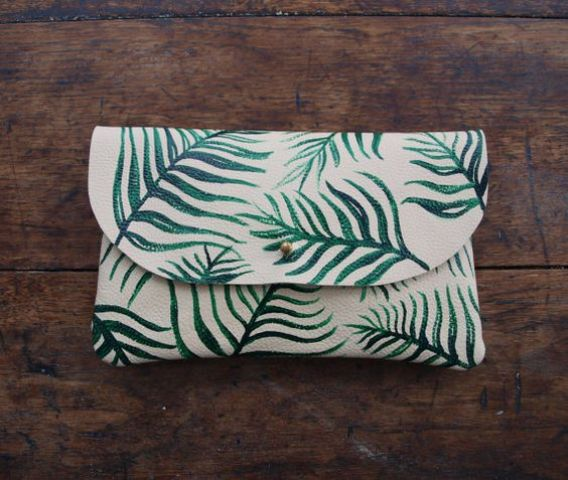 a white leather lutch with a fern print is ideal for summer