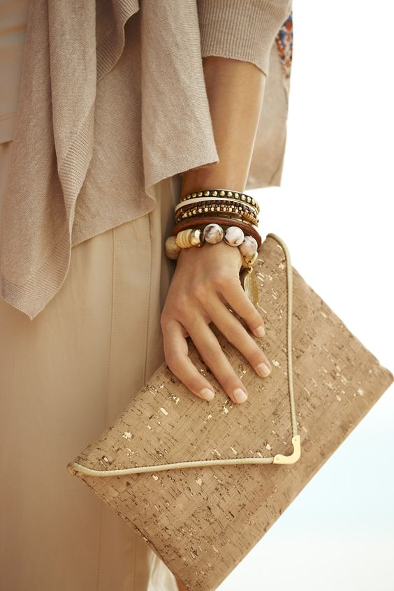 a cork clutch with copper leaf decor and metallic detailing