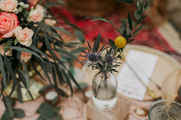 billy ball bud vases with thistle - photo by Sarah White Photography http://ruffledblog.com/boho-bridal-shower-inspiration-for-your-bride-tribe
