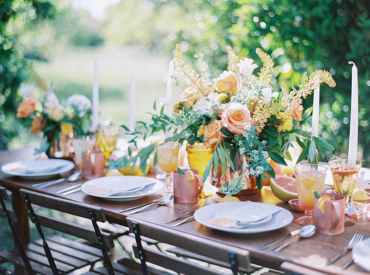 wedding tablescapes - photo by Melissa Jill Photography http://ruffledblog.com/citrus-and-copper-orchard-wedding-inspiration
