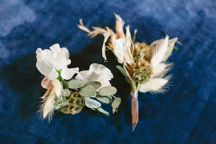 rustic groom boutonnieres - photo by Leigh Miller Photography http://ruffledblog.com/modern-wedding-inspiration-with-a-pampas-grass-chandelier