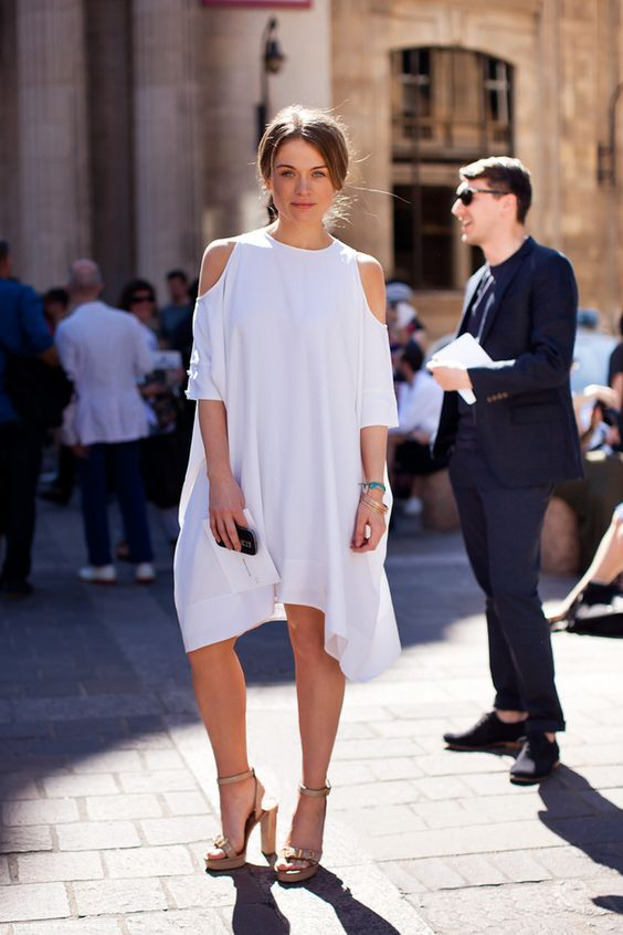 modern plain dress with a cold shoulder and an asymmetric edge, nude shoes