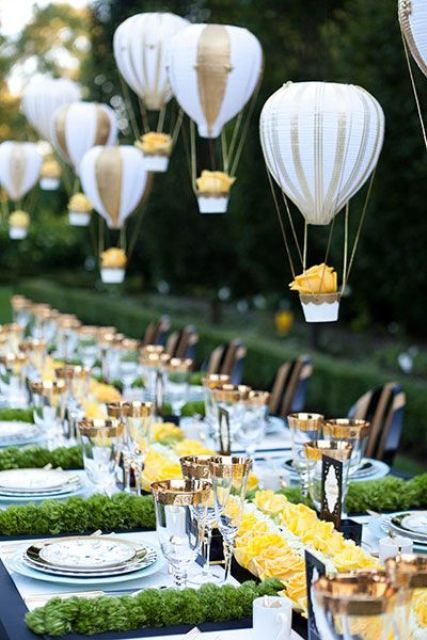 balloons in hot air balloons hanging over the reception create a dreamy ambience