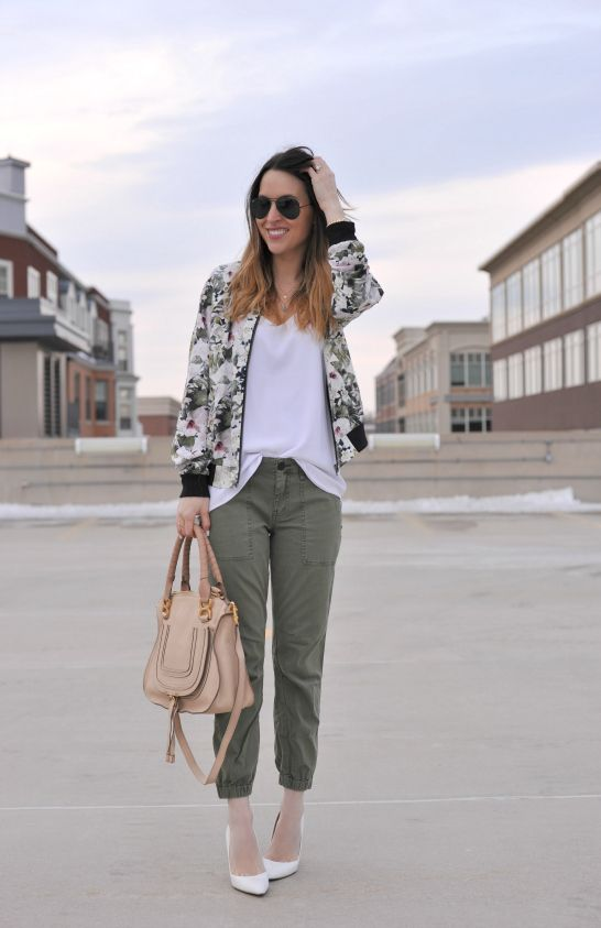khaki pants, a white tee, a green floral print bomber jacket and white shoes