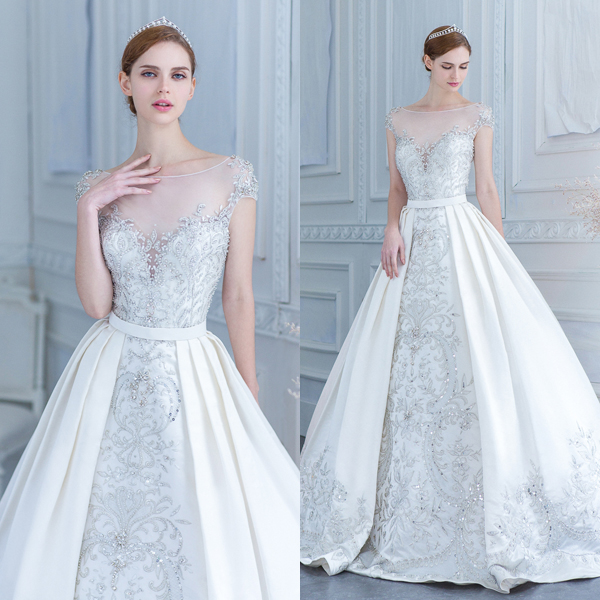 beaded A-line silver wedding dress with an illusion neckline and an overskirt for more volume